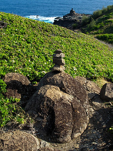 I'm not sure why but people seem to take pride in stacking four or five rocks all along the road around Kahakuloa side. I don't know if the really large rock on the far horizon was balanced there by man or by wind and salt spray.