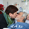 Maurice La-Garde's a kiss from his wife Heike Petermann while in his bad at the Whittier Rehabilitation Hospital in Haverhill on Thursday morning. Maurice has been a quadriplegic since a 1987 swimming pool accident and recently contracted a flesh-eating bacteria and has been stuck in a rehab facility ever since. He and his family are desperate to bring him home before Christmas, and are trying to raise $40,000 to get the equipment he needs to make that possible. SUN/JOHN LOVE
