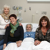 Maurice La-Garde in his bed at the Whittier Rehabilitation Hospital in Haverhill on Thursday morning. With him is his mother Hazel La-Garde, wife Heike Petermann and sister Yvonne La-Garde.  SUN/JOHN LOVE