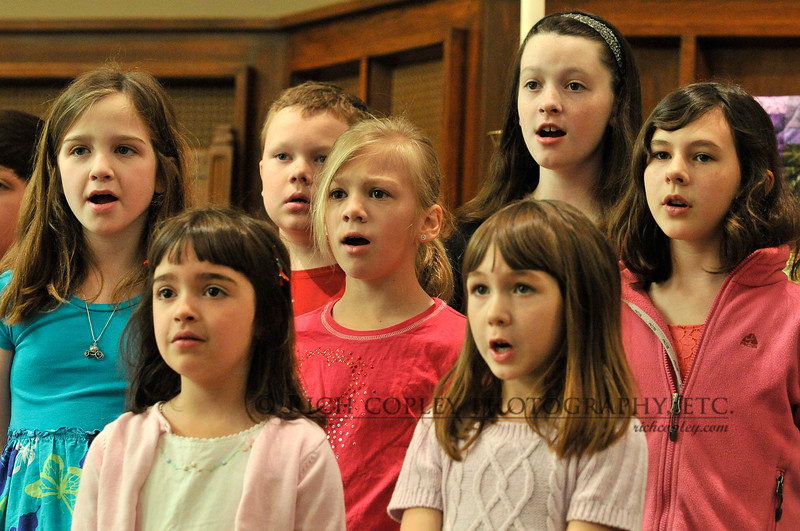 March 25, 2012 - Shooting the children's choir while it rehearsed before this morning's service gave me a chance to zoom in a bit and capture some of those precious expressions. (101/366)