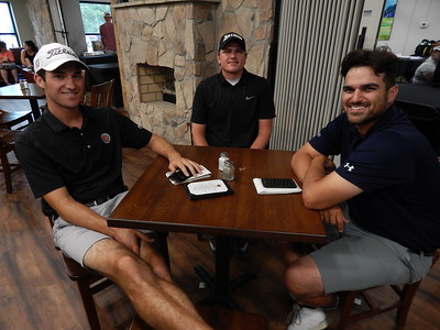 NATHAN DEAL/Phoenix Staff Photo At the table, from left, APT golfers Andrew Buchanan, Daniel Miernicki and Patrick Simard wait out the rain on Wednesday at Muskogee Golf & Country Club. A late morning storm system forced cancellation of play.