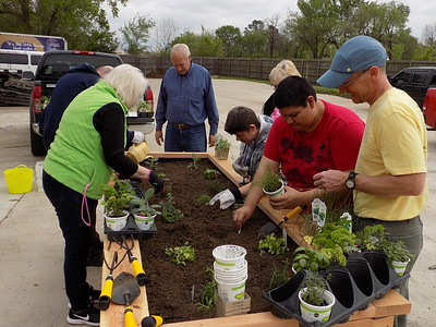 MIKE ELSWICK/Muskogee Phoenix Volunteers from the Master Gardeners of Muskogee County worked with partners at Golden Rule Industries on how to get started in raised bed gardening for the nonprofit serving clients in a five-county area.