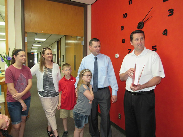 CATHY SPAULDING/Muskogee Phoenix.<br /> Sallisaw School Superintendent Scott Farmer, second from right, and his family meet Fort Gibson Superintendent Derald Glover after Farmer was hired as Glover's replacement on Thursday. Joining them are Farmer's wife, Emily, second from left, and their children, from left, Kaycie, David and Jessie.