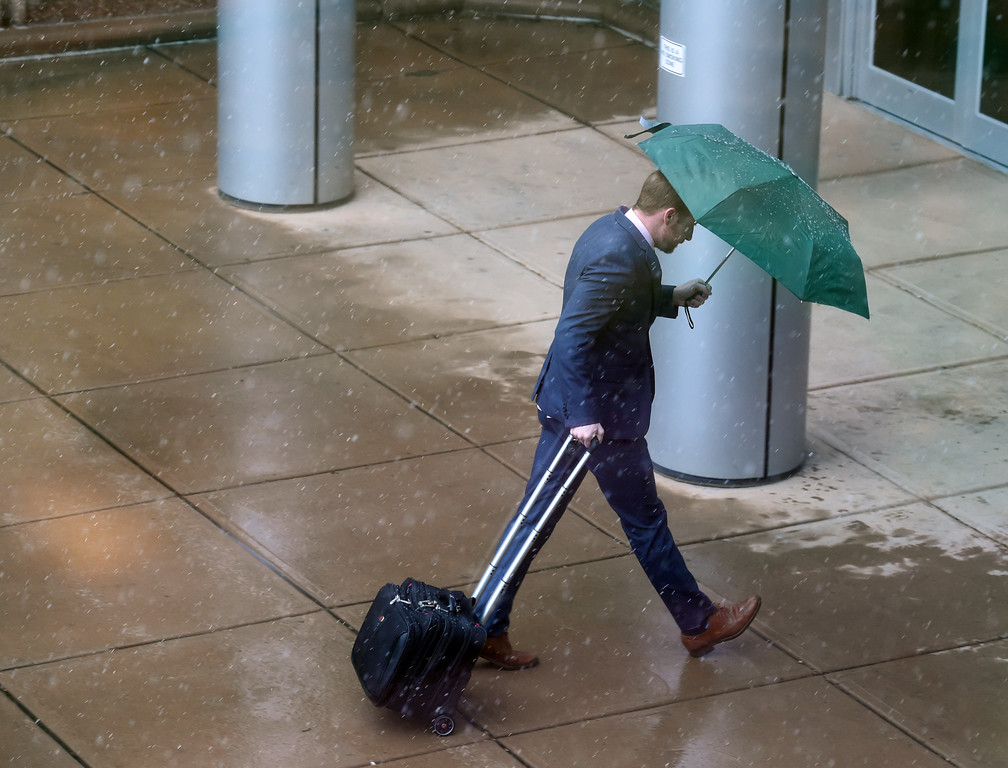 . A man makes it to the entrance of the Boulder County Justice Center  during a steady rain/snow mix in Boulder County. For more photos, go to www.dailycamera.com.  Cliff Grassmick  Staff Photographer May 18, 2017