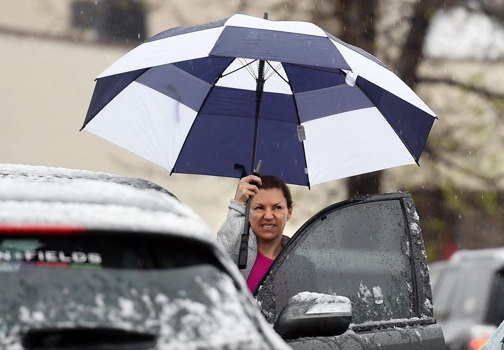 . A woman gets in her car outside 24Hour Fitness during a steady snow/rain mix  in Boulder early Thursday morning. For more photos, go to www.dailycamera.com.  Cliff Grassmick  Staff Photographer May 18, 2017
