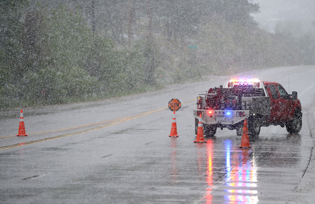 . Traffic is blocked on U.S. 36., near Planet Bluegrass, in Lyons Thursday afternoon, due to the heavy snow between Lyons and Estes Park. Lewis Geyer/Staff Photographer May 18, 2017