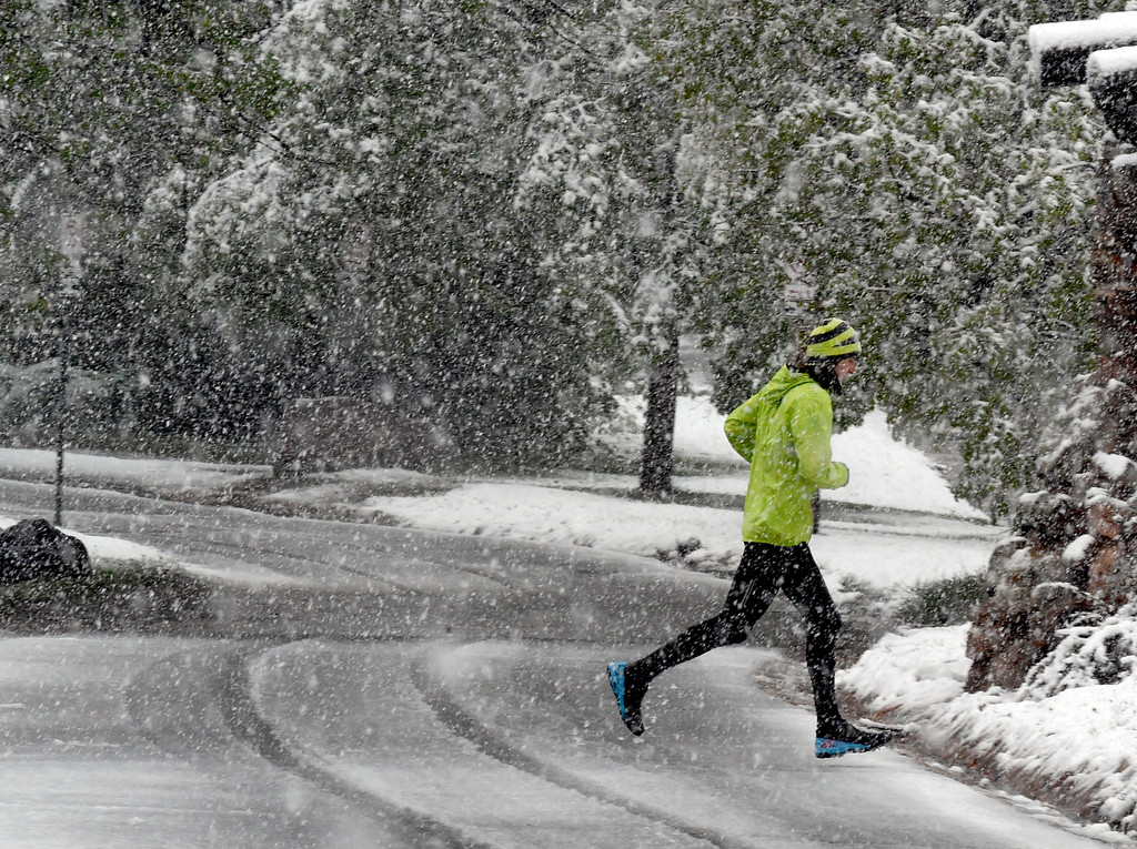 . A runner doesn\'t  let the weather stop them at Chautauqua Park during a steady rain/snow mix in Boulder County. For more photos, go to www.dailycamera.com.  Cliff Grassmick  Staff Photographer May 18, 2017