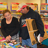 Darci Joy and dad Craig look over some books during Family Reading Night at Beecher City Grade School.