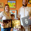 Brittany, Alexander and Nick Palmer show off some of the albums the family found.