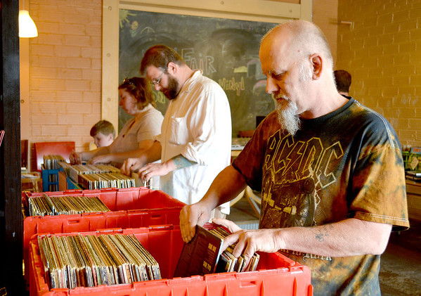 Mike Ratcliffe arranges some of the 200 albums he bought to sell and trade at a Record Fair Held at Joe Sipper's Saturday.