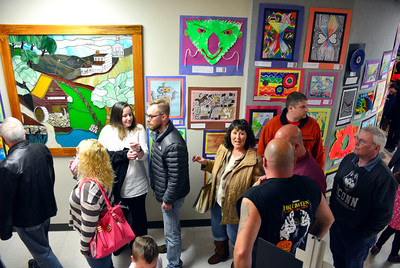 5/3/2016 Mike Orazzi | Staff Parents and student admire students work during the art show at the  Bristol Board of Education on Church Street Tuesday night.