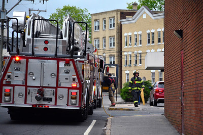 5/4/2016 Mike Orazzi | Staff Members of the Bristol fire department while responding to a report of burned popcorn at 222 Main Street in Bristol Wednesday.