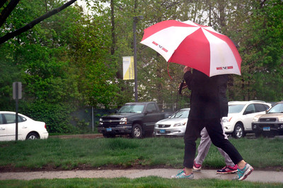 5/3/2016 Mike Orazzi | Staff Pedestrian's walk along Brewster Road in Bristol during a rainy Tuesday in Bristol.