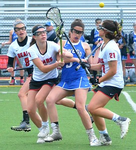 KYLE MENNIG - ONEIDA DAILY DISPATCH Chittenango's Shelby Maring (1) checks Oswego's Madelaine Taylor (3) during their game in Chittenango on Saturday, May 6, 2017.