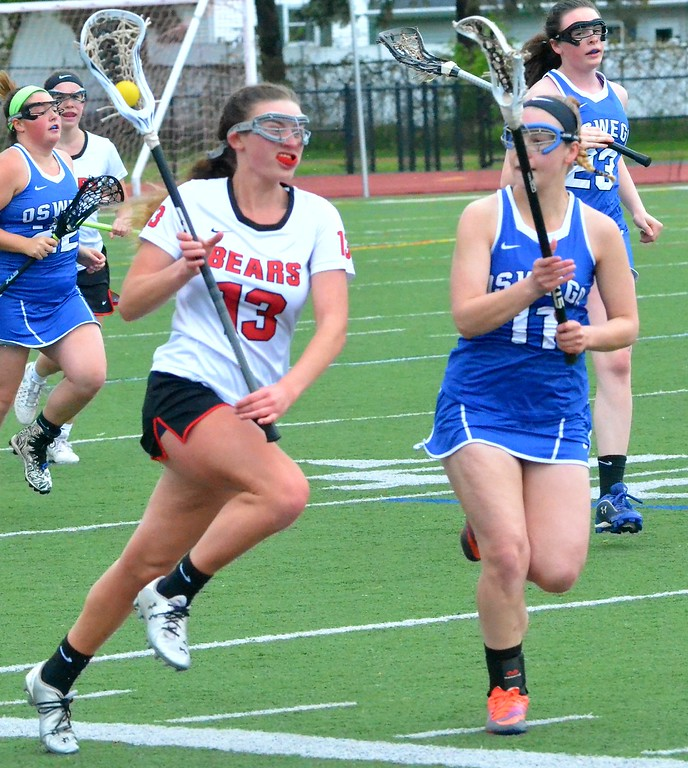. KYLE MENNIG - ONEIDA DAILY DISPATCH Chittenango\'s Alyssa Frantz (13) brings the ball up the field as Oswego\'s Grace Bruns (11) during their game in Chittenango on Saturday, May 6, 2017.