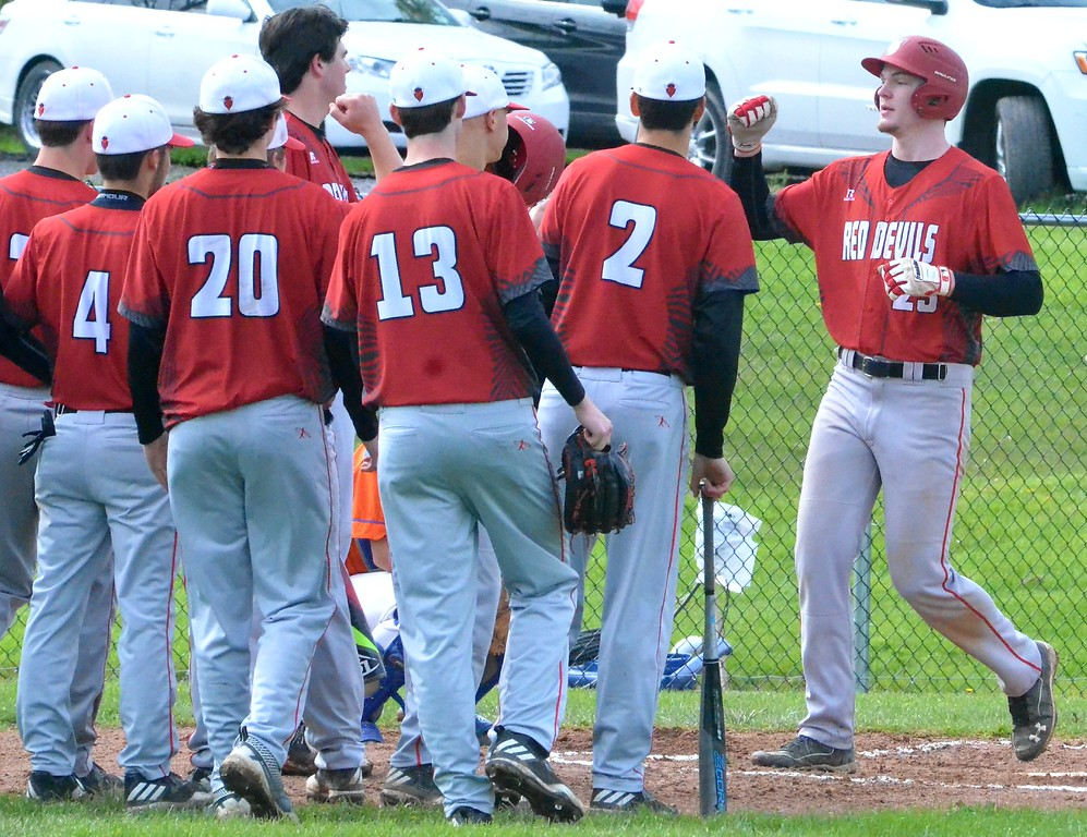 . KYLE MENNIG - ONEIDA DAILY DISPATCH Vernon-Verona-Sherrill\'s Davey Moffett (23) is greeted at home plate by his teammates after hitting a home run against Oneida during their game in Oneida on Tuesday, May 9, 2017.
