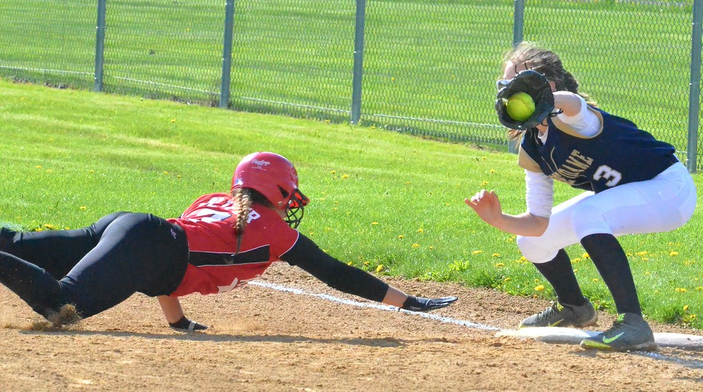 . KYLE MENNIG - ONEIDA DAILY DISPATCH Vernon-Verona-Sherrill\'s Kirsten Oliver (7) dives safely back into first as Utica Notre Dame\'s Izzi Green (3) fields the throw during their game in Verona on Wednesday, May 3, 2017.