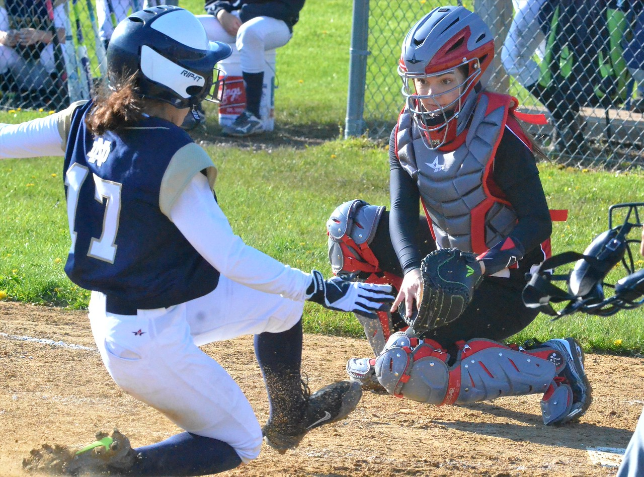 KYLE MENNIG - ONEIDA DAILY DISPATCH Utica Notre Dame's Aubree Jabour (17) slides safely into home as Vernon-Verona-Sherrill catcher Keely Alsheimer looks to put the tag down during their game in Verona on Wednesday, May 3, 2017.
