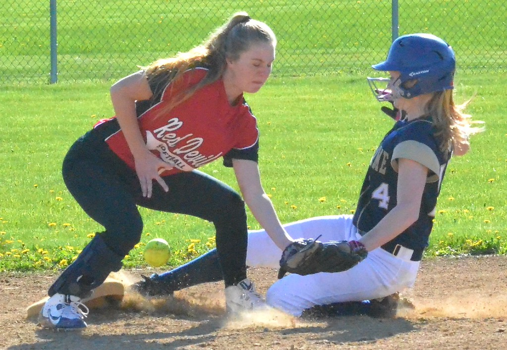 . KYLE MENNIG - ONEIDA DAILY DISPATCH Utica Notre Dame\'s Sofia Gardinier (4) slides safely into second as the ball gets away from Vernon-Verona-Sherrill\'s Malia Minckler during their game in Verona on Wednesday, May 3, 2017.