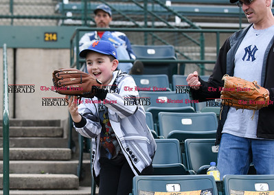 050117  Wesley Bunnell   Staff  New Britain Bees vs the Somerset Patriots on Monday evening. Alexander Misarti, age 9, catches a ball thrown by Somerset 1st baseman at the end of the inning.
