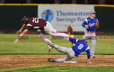 050117  Wesley Bunnell   Staff  Bristol Eastern baseball defeated Bristol Central at Muzzy Field on Monday evening. Bristol Eastern's short stop Cory Fradette (8) turns the double play after getting mixed up with Stephen Warkowski (25).