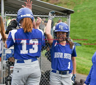 050117  Wesley Bunnell   Staff  Bristol Eastern defeated Bristol Central softball on Monday afternoon. Bristol Eastern's Taylor Keegan (1) high gives Erin Girard (13) after coming home to score.
