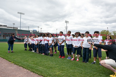050317  Wesley Bunnell | Staff  New Britain Bees vs Somerset Patriots in a Wednesday morning game attended by areas school children. Students from Fair Haven School in New Haven sing God Bless America.