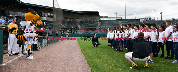 050317  Wesley Bunnell | Staff  New Britain Bees vs Somerset Patriots in a Wednesday morning game attended by areas school children. Students from Fair Haven School in New Haven sing God Bless America as Sting conducts.