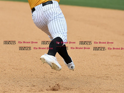 050317  Wesley Bunnell   Staff  New Britain Bees vs Somerset Patriots in a Wednesday morning game attended by areas school children. Craig Maddox (24) rounds first base.