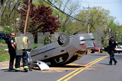 5/4/2017 Mike Orazzi | Staff The scene of a single car rollover crash on Stevens Street in Bristol Thursday afternoon. The driver was able to crawl out of the car on his own and refused treatment.