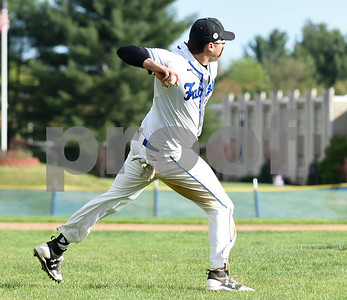 050817  Wesley Bunnell | Staff  St. Paul Catholic baseball defeated Seymour on Monday afternoon 5-0. Third baseman Andrew Owsianko (10) comes in on a softly hit ball to make a bare handed play for the out.