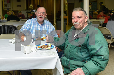 050917  Wesley Bunnell | Staff  New Britain's homeless are invited to St. Peter's Church on Tuesday evening for a free meal served by volunteers. John Moroni , L, sites with John Sargis.