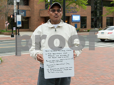 050917  Wesley Bunnell | Staff  The New Britain NAACP held a conference and rally Tuesday night at Central Park in support of more diversity amongst the city's fire department and to call for investigations involving racial bias within the department. Community activist Mario Santos holds a sign in support for more diversity among the fire department.