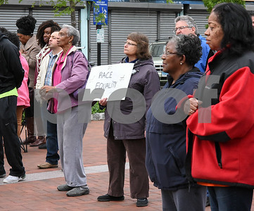 050917  Wesley Bunnell | Staff  The New Britain NAACP held a conference and rally Tuesday night at Central Park in support of more diversity amongst the city's fire department and to call for investigations involving racial bias within the department. Several signs of support were held during the rally.