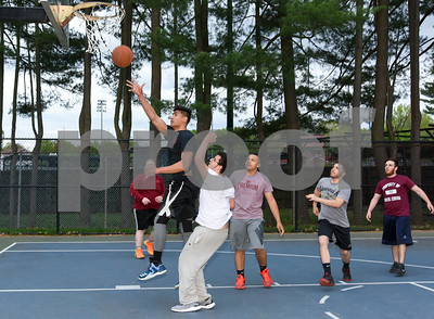 050917  Wesley Bunnell | Staff  Playing basketball in Rockwell Park just beyond the outfield fence of Muzzy Field are Austin Sloan, L back, Tyler Boi going up for the shot, Alejandro Gonzalez, Devante Pearson & Ryan Coderre far right.