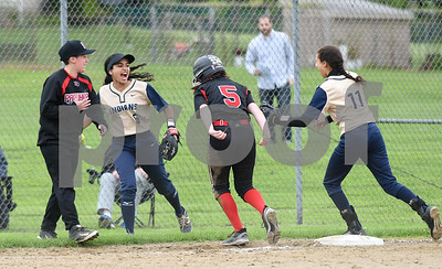 051017  Wesley Bunnell | Staff  Newington High School softball vs E.O. Smith on Wednesday afternoon. Cyan Gonzalez (6) celebrates after making a catch and forcing the runner on third.