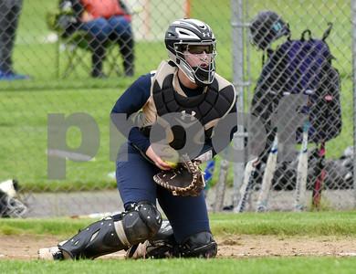 051017  Wesley Bunnell | Staff  Newington High School softball vs E.O. Smith on Wednesday afternoon. Catcher Kinsey DelBuono (13).