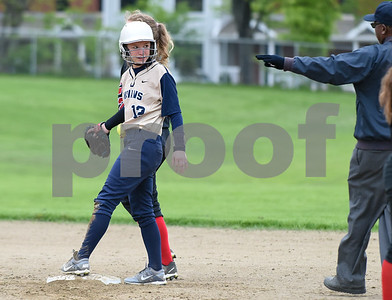 051017  Wesley Bunnell | Staff  Newington High School softball vs E.O. Smith on Wednesday afternoon. Savannah Jelm (12) looks to the umpire for the call at second base.