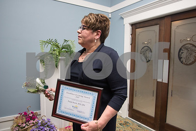 051017  Wesley Bunnell | Staff  Bristol Hospital held their nursing award ceremony on Wednesday evening at the Chippanee Golf Club. Paula Steele, L, stands to the side after accepting her Excellence in Caring & Exemplary Practice Award.