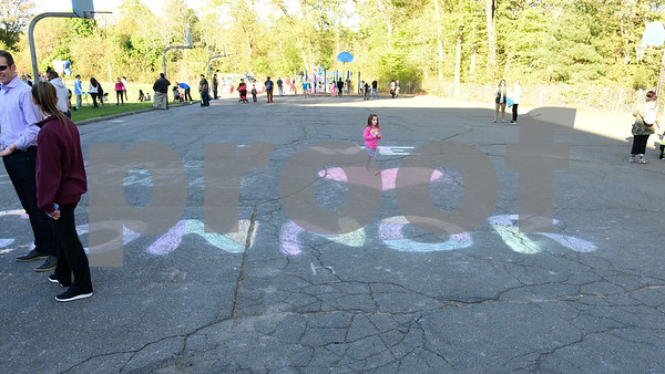051117  Wesley Bunnell | Staff  A Relay for Life was held on Thursday at South Side School to benefit 10 year old Connor Albert, aka Captain Connor, who was diagnosed with a form of bone cancer in April 2016. A girl walks across chalk spelling out support for Connor near the playground.