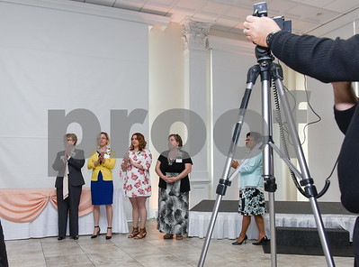 051117  Wesley Bunnell | Staff  Recipients stand to the side waiting for their name to be called during the New Britain YWCA's 17th Biennial Women in Leadership Luncheon at the Aqua Turf on Thursday afternoon.