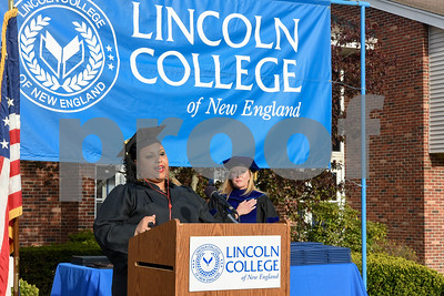051217  Wesley Bunnell | Staff  Lincoln College New England held their commencement exercises for new graduates on Friday evening on campus. Mortuary Science graduate Jenna Glasper performs the National Anthem with President Denise Lewicki to the right.