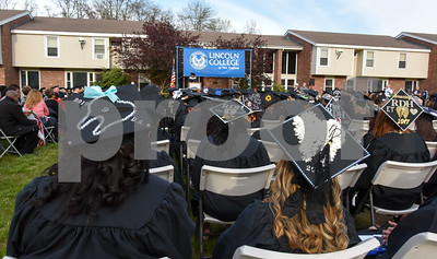 051217  Wesley Bunnell | Staff  Lincoln College New England held their commencement exercises for new graduates on Friday evening on campus. Students with decorated mortar boards listen at FBI agent Rhonda Glover delivers the keynote address.