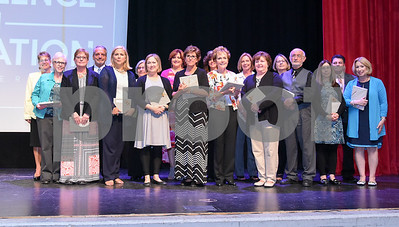 051517  Wesley Bunnell | Staff  The First Annual Excellence in Education Awards Ceremony took place at New Britain High School on Monday evening. The group of retirees pose for photos with school administrators. Together the teachers retiring combined for 633 years of service to New Britain.