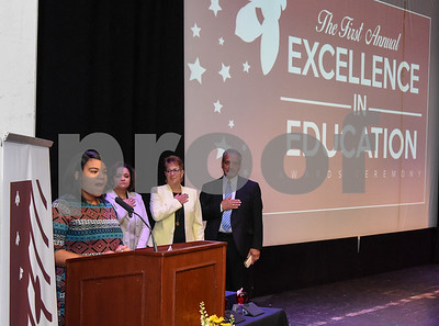 051517  Wesley Bunnell | Staff  The First Annual Excellence in Education Awards Ceremony took place at New Britain High School on Monday evening.  Alaizha Franklin performs the National Anthem  as Chief Talent Officer Dr. Shauna Tucker, Superintendent of Schools Nancy Sarra and Chief Operations Officer Paul Salina look on.