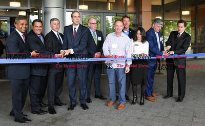 052217  Wesley Bunnell | Staff  Webster Bank held a ribbon cutting ceremony at its newest corporate office at 200 Executive Blvd in Southington along with town officials and members of the chamber of commerce. Performing the ribbon cutting are Nitin Mahatre, L, Economic Development Director Louis Perillo, President John Ciulla, 4th from left, event emcee Tim Bergstrom, town council chairman Michael Riccio, town manager Gary Brumback, Executive Director of the Southington Chamber of Commerce Elizabeth Hyatt,  Waterbury Regional President Michael O'Connor & Webster Bank's CEO Jim Smith.
