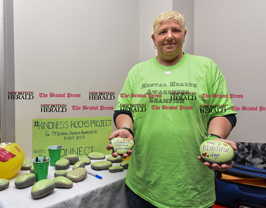 052217  Wesley Bunnell | Staff  Jules Calabro from Beacon Health Options holds rocks with words of kindness as part of the #kindnessrocksproject on Monday evening during the Bristol Wellness & Resource Fair at the Boys and Girls Club. The fair featured area resources for the benefit of Bristol families. Zumba, Yoga, Sound Meditation, LesMills Bodyvive, health & wellness vendors as well as the Kindness Rocks Project. The event was sponsored by Beacon Health Options, Toivo and FAVOR in partnership with CONNECT. May is mental health month.