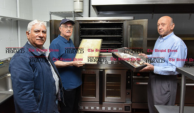 052217  Wesley Bunnell | Staff  Food preparation is underway for St. George Greek Orthodox Church's 34th annual Dionysos Festival. President Michael T. Michae, L,  Chef James Soukas, & Asst. Chef John Georgopoulus.