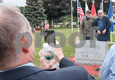 052917  Wesley Bunnell | Staff  Plainville held their annual Memorial Day Parade on Monday morning followed by a memorial unveiling dedicated to Gold Star Families at Veterans Memorial Park. State Senator Henri Martin takes a photo on his cell phone of Bob Doolittle & Dan Burgess. Bob came up with the idea for the memorial and proceeded with help from friend Dan.