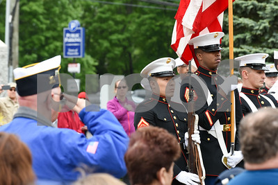 052917  Wesley Bunnell | Staff  Plainville held their annual Memorial Day Parade on Monday morning followed by a memorial unveiling dedicated to Gold Star Families at Veterans Memorial Park. A veteran salutes during the ceremony with the Marine Honor Guard in the background.